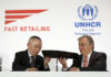 Antonio Guterres, right, United Nations High Commissioner for Refugees, and Tadashi Yanai, left, founder and president of Fast Retailing Co. exchange signed documents in Tokyo Wednesday, Nov. 25, 2015. Guterres, says Japan should be doing more to help with the global catastrophe of asylum seekers. Guterres spoke at an event where the Japanese apparel company, Fast Retailing, announced a partnership with the UNHCR to expand its support for refugees, which includes internships and donations of funds and of recycled clothing. (AP Photo/Eugene Hoshiko)